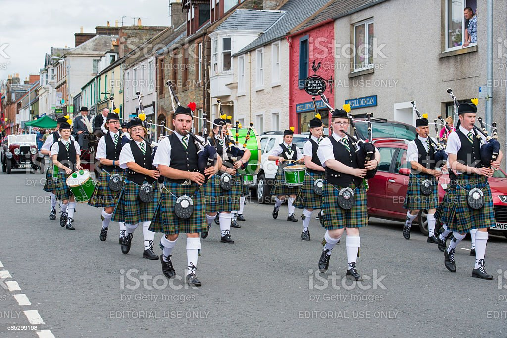 Members of a Scottish pipe band in a summer parade stock photo