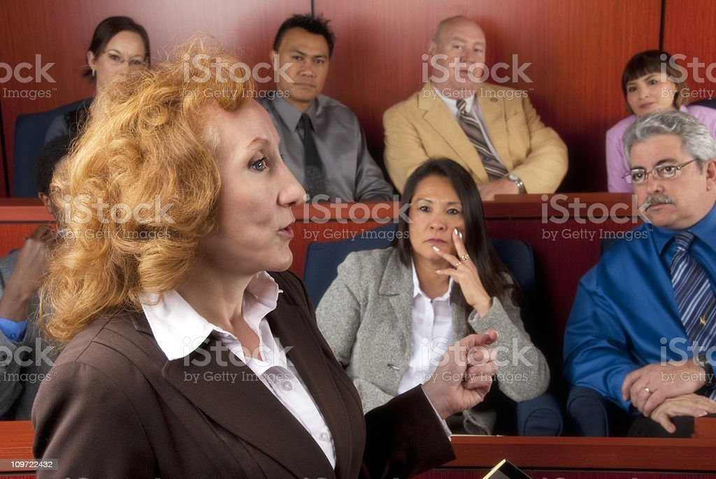 Members of diverse jury listening to an attorney in courtroom royalty-free stock photo