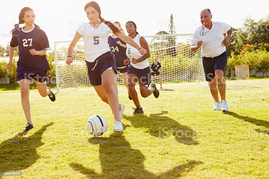 Members Of Female High School Soccer Playing Match stock photo