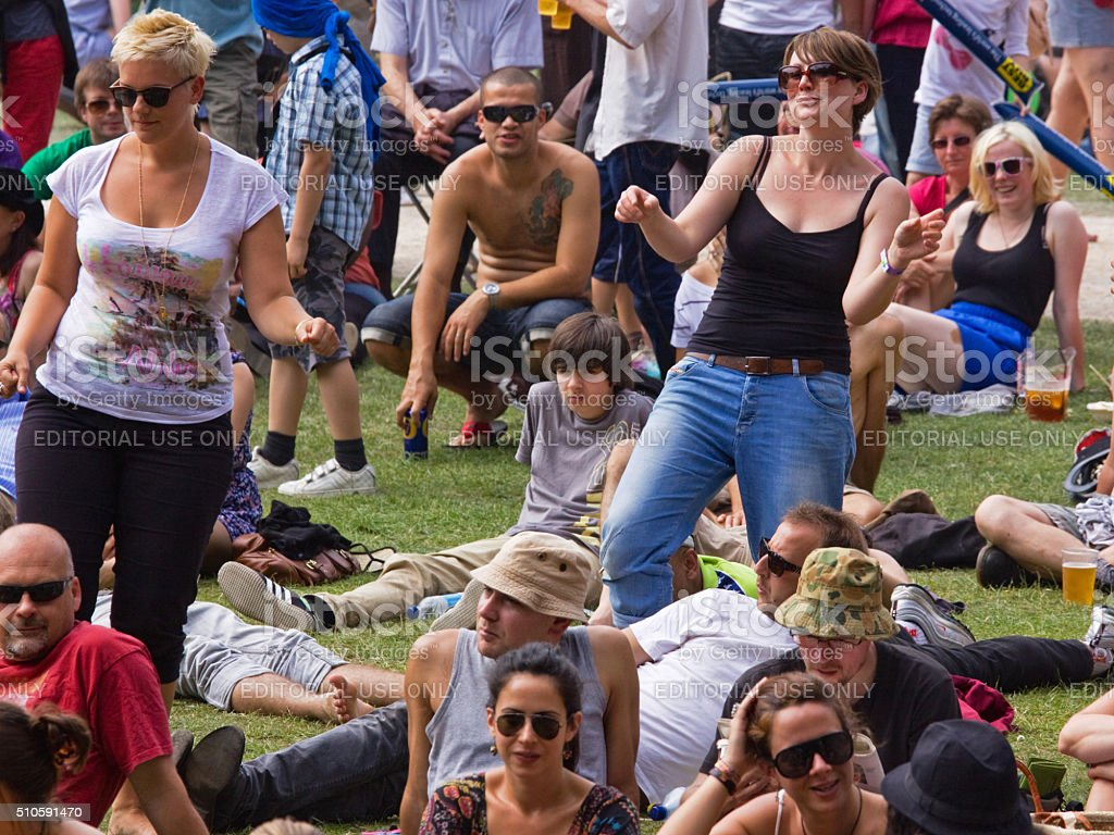 Members of the audience enjoying themselves at a music festival stock photo