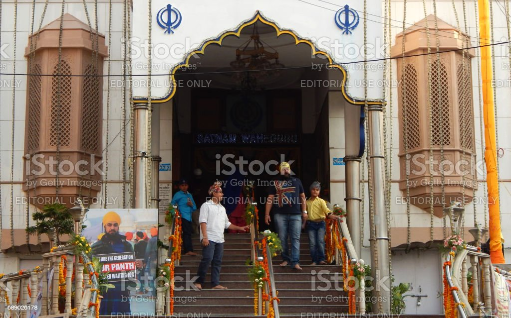 Members of the Sikh community visit Gurudwara Saheb Ameerpet on 318th Khalsa Panth Foundation Day or Baisakhi festival to offer prayers,in Hyderabad,India stock photo