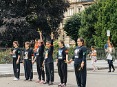 Members of Turkey's Alevi community protesting girls with peace t-shirts