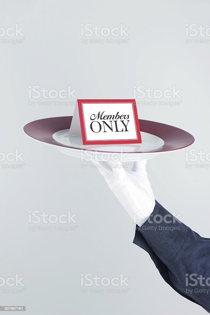 Members Only Card On Platter Held By Waiter stock photo