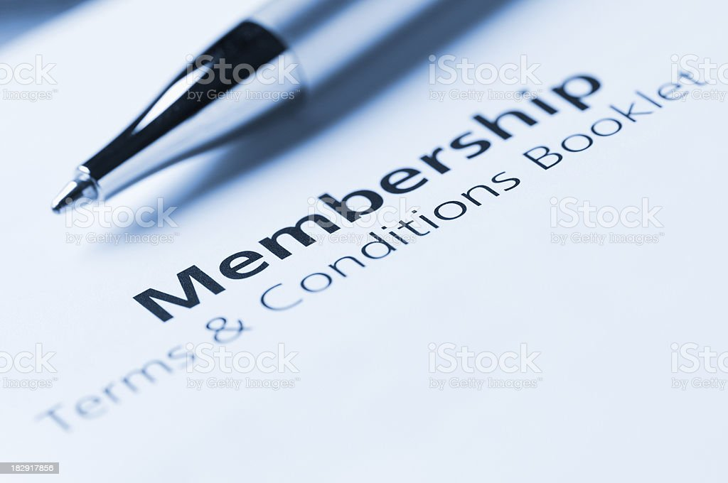Membership terms and conditions with silver pen royalty-free stock photo
