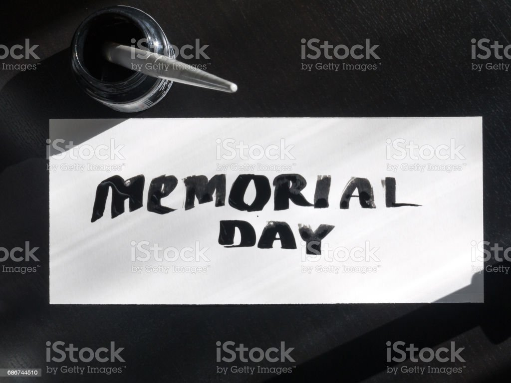 Memorial day calligraphy and lettering post card with inkstand. Top view and sunlight stock photo