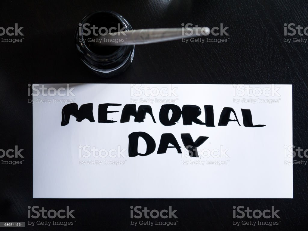Memorial day calligraphy and lettering post card with inkstand. Top view stock photo