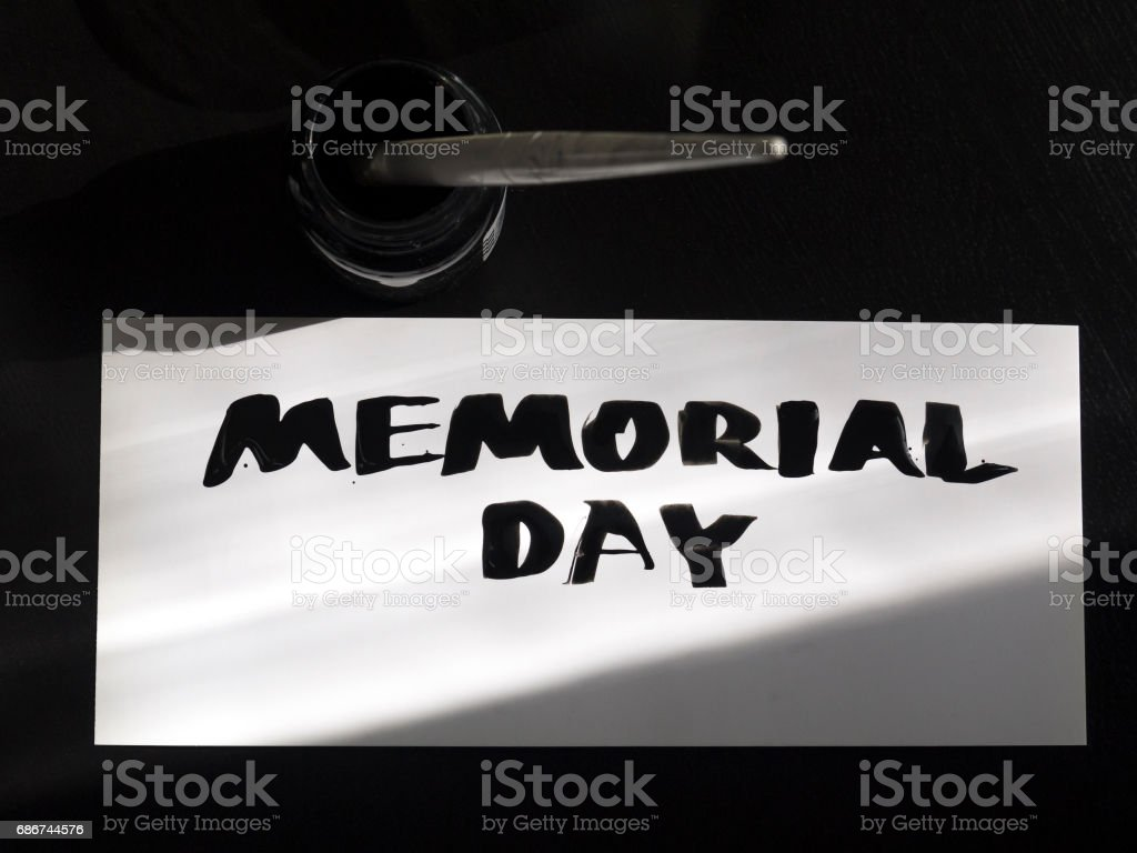 Memorial day calligraphy and lettering post card with inkstand. Top view and sunlight shadow stock photo