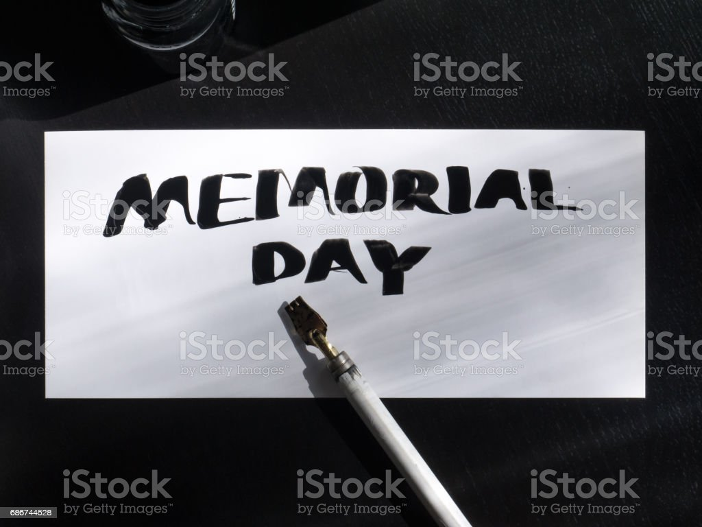 Memorial day calligraphy and lettering post card with wild pen. Top view stock photo