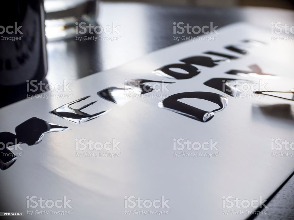 Memorial day calligraphy and lettering post glossy card. Extremely close-up stock photo