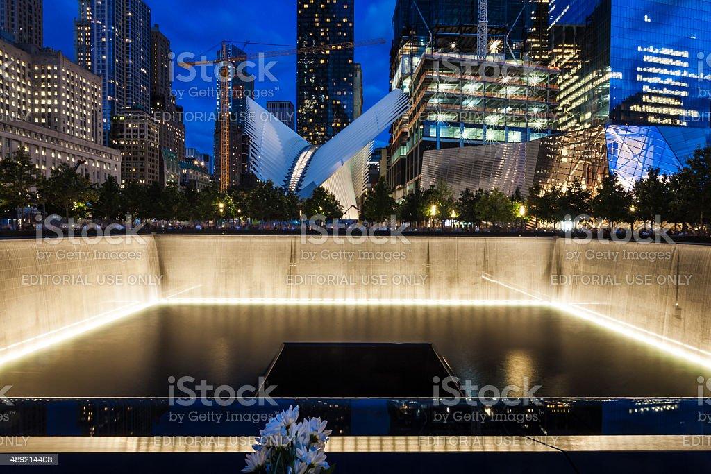9/11 Memorial pool at night on 9/11 stock photo