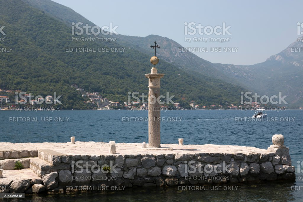 Memorial sign on the site where the icon of Our Lady was found on Our Lady of the Rocks, Montenegro. stock photo