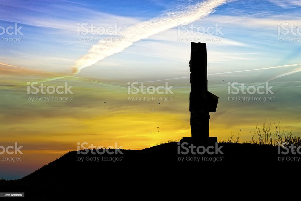 Memorial silhouetted against the sunset stock photo
