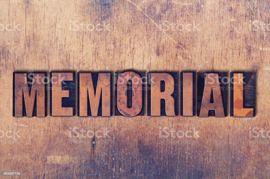 Memorial Theme Letterpress Word on Wood Background stock photo