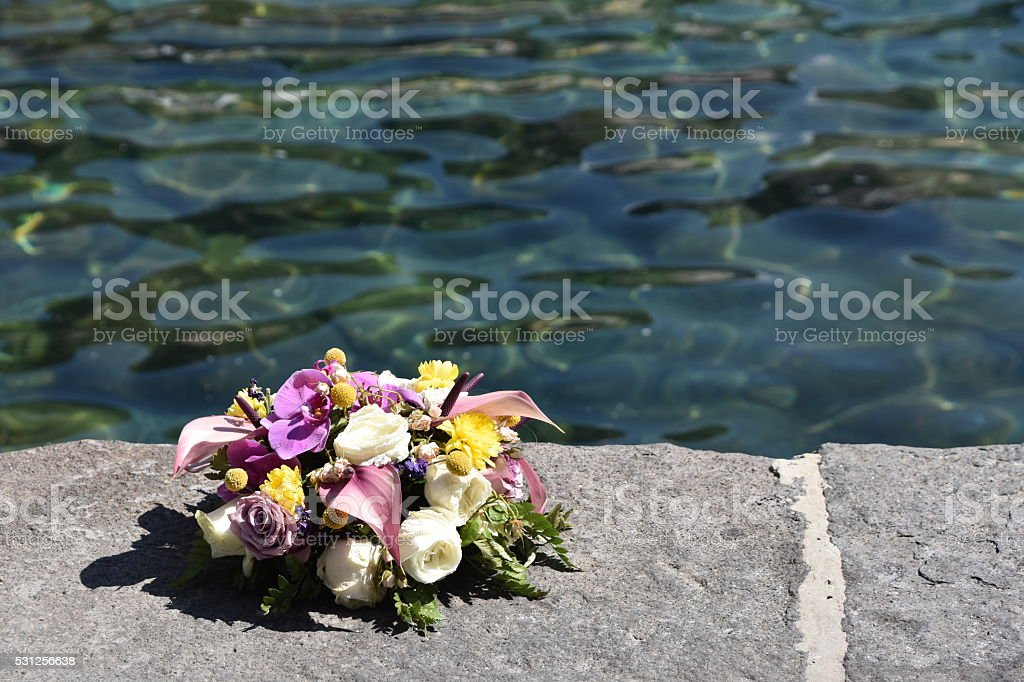 memorial wreaths on the sea for sailors stock photo