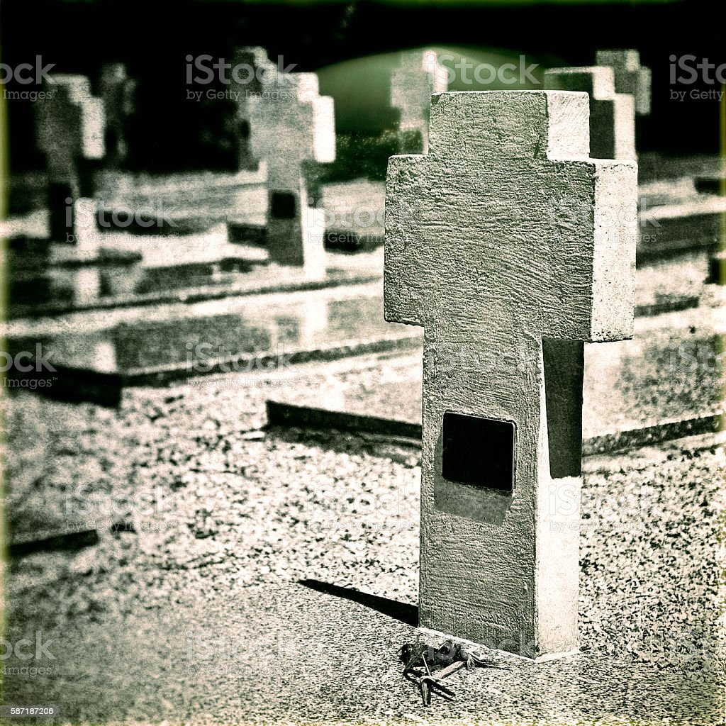 Memorial WWII cemetery gravestones old photo with multiple cross shapes stock photo