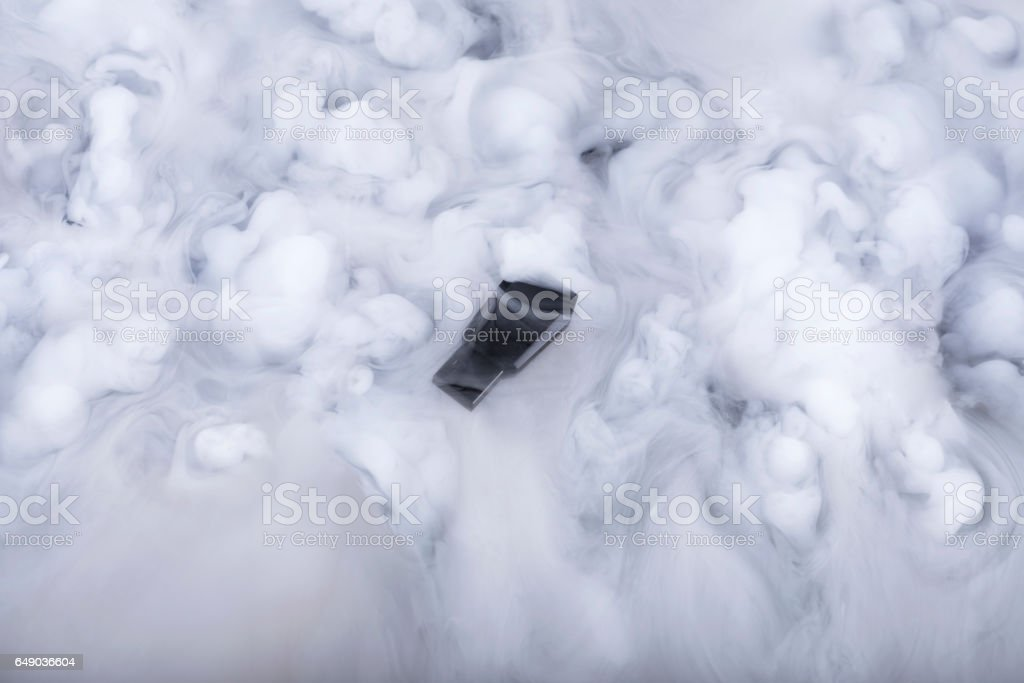 Memory stick in the clouds stock photo