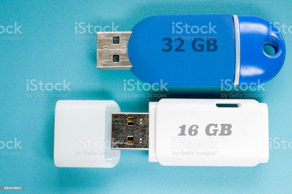 Memory sticks on blue background stock photo