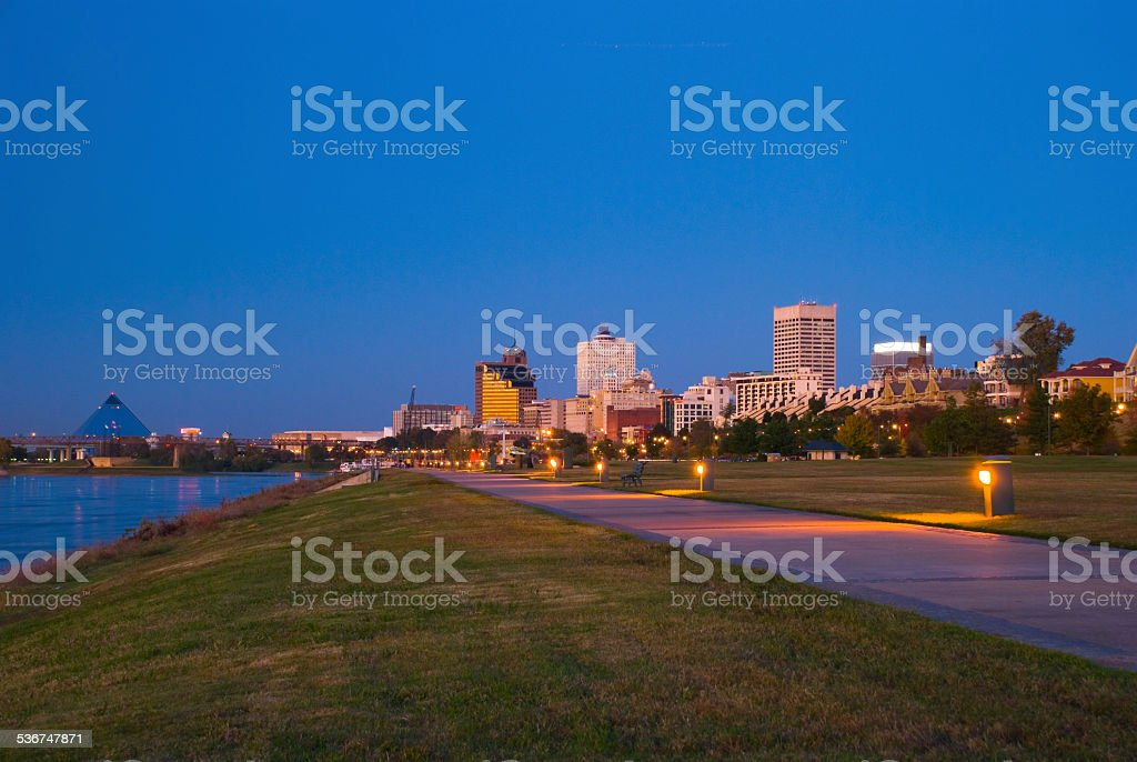 Memphis skyline, park, river, and pyramid at dusk stock photo