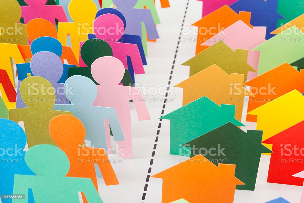 Men and houses separation stock photo