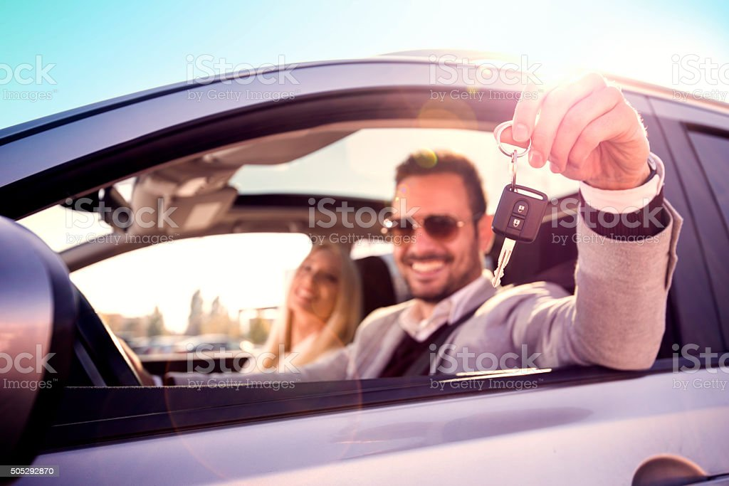Men and woman bying a car stock photo