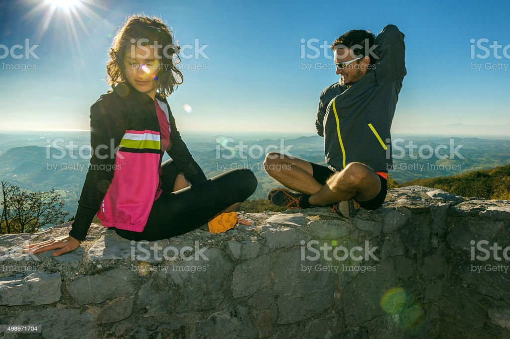 Men and woman stretching on the wall, Nova Gorica,Slovenia stock photo