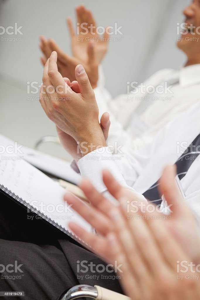 Men and women clapping their hands stock photo