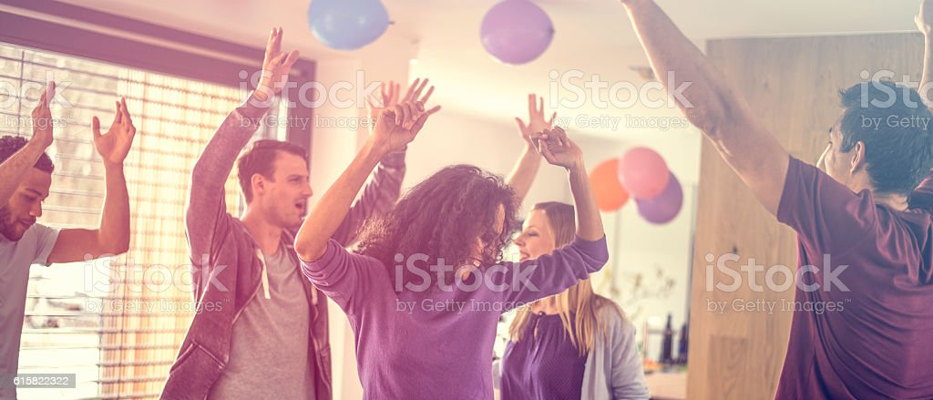 Men and women dancing at a party stock photo