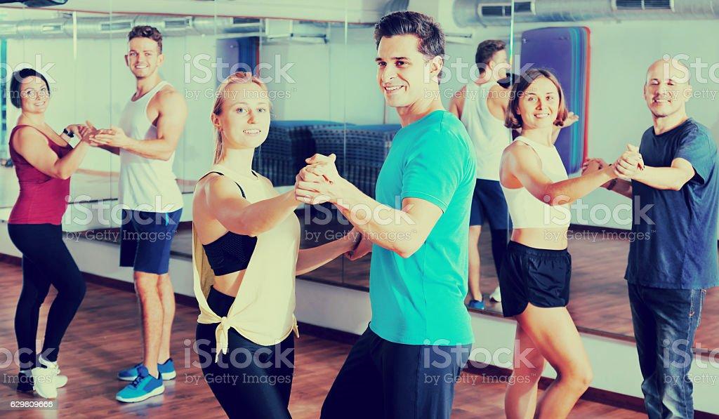 Men and women dancing salsa o bachata stock photo