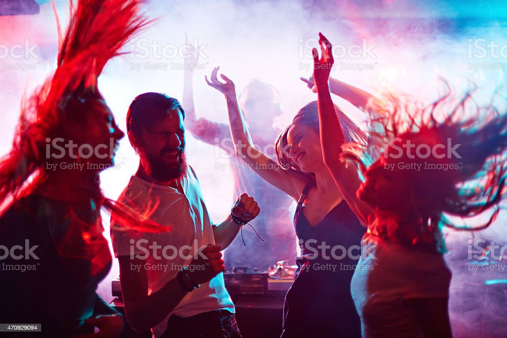 Men and women dancing very enthusiastically stock photo