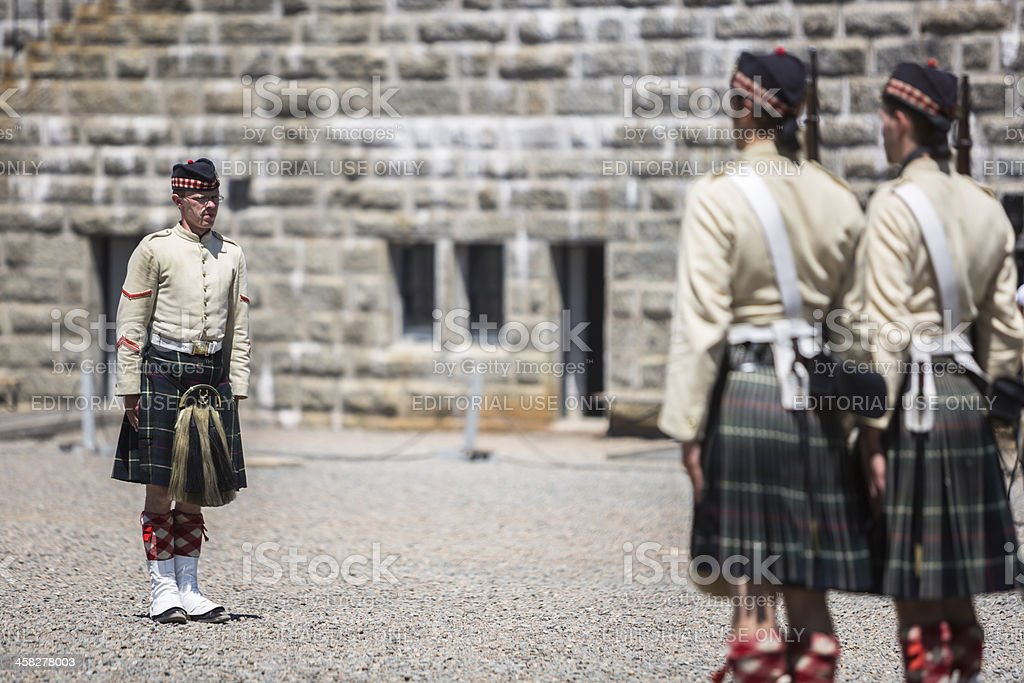 Men and women dressed like 78th Highland Regiment soldiers royalty-free stock photo