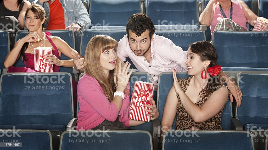 Men and Women Flirting in Theater royalty-free stock photo