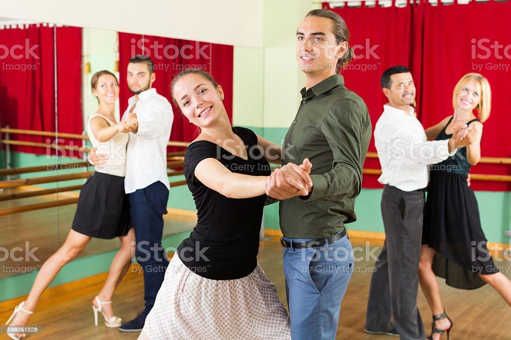 men and women having dancing class in studio stock photo