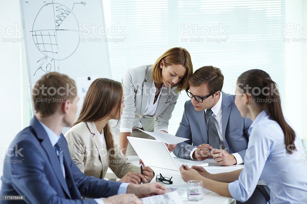 Men and women in a business meeting stock photo