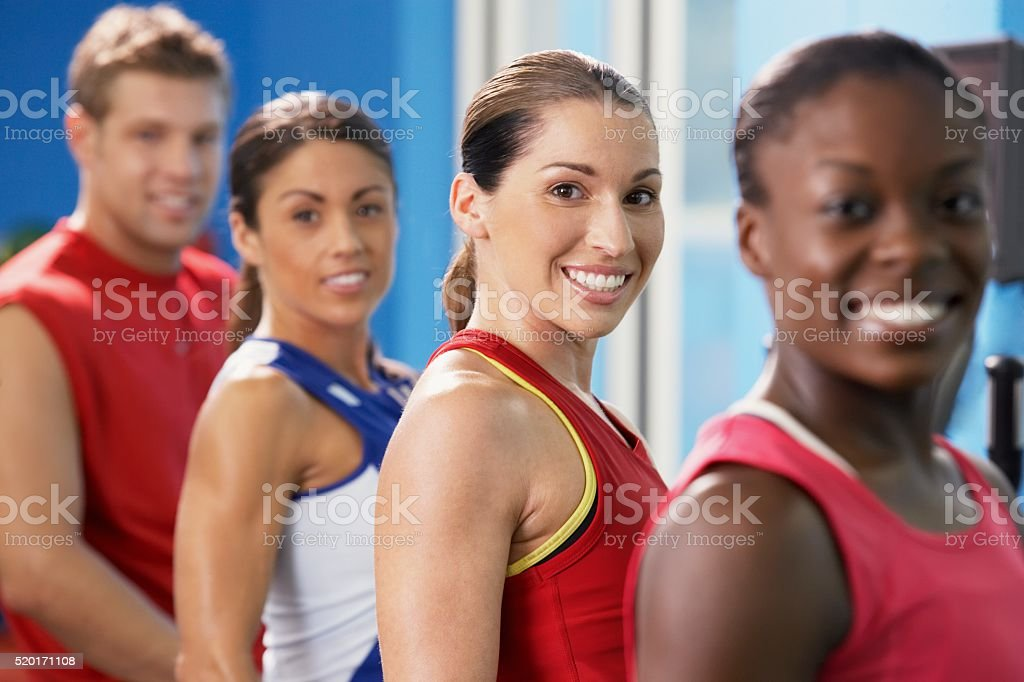 Men and women in a gym stock photo