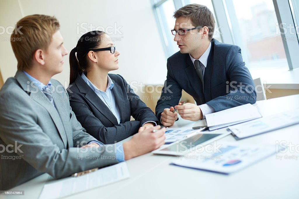 Men and women in a picture doing business within a group royalty-free stock photo