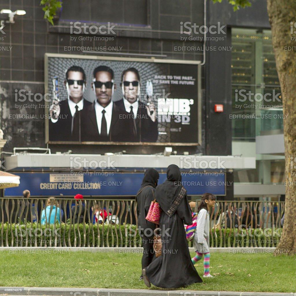 Men, and women, in black stock photo