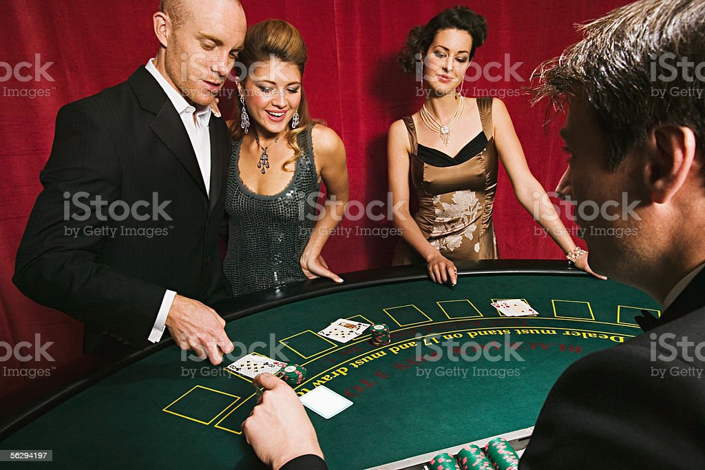 Men and women playing blackjack stock photo
