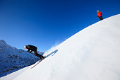 Men and women snow skiers off piste skiing powder snow