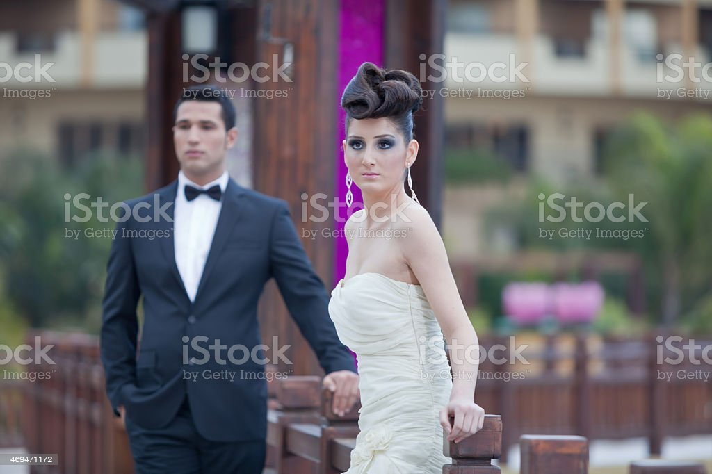 men and women standing together stock photo