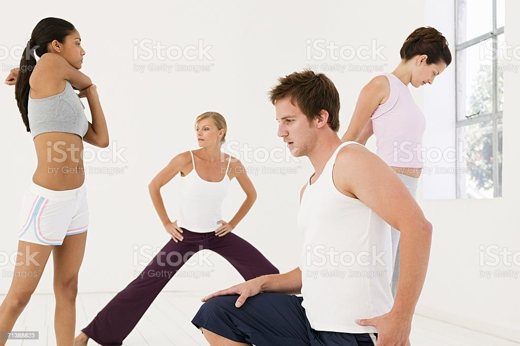 Men and women stretching royalty-free stock photo