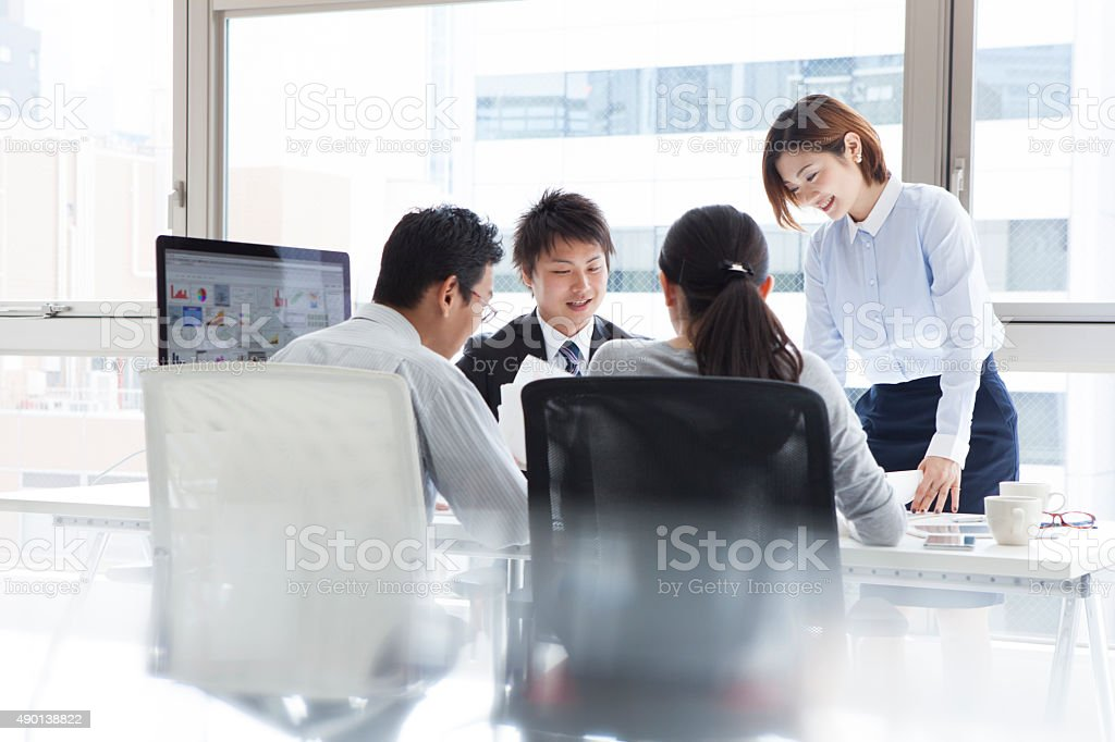 Men and women to discuss happily stock photo