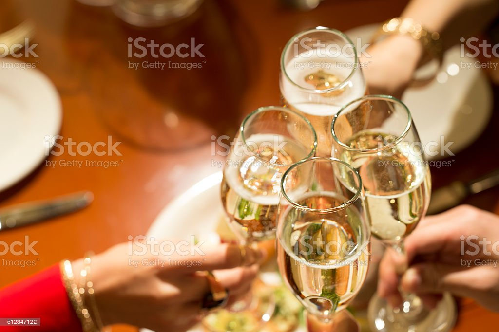 Men and women to toast at a birthday party stock photo