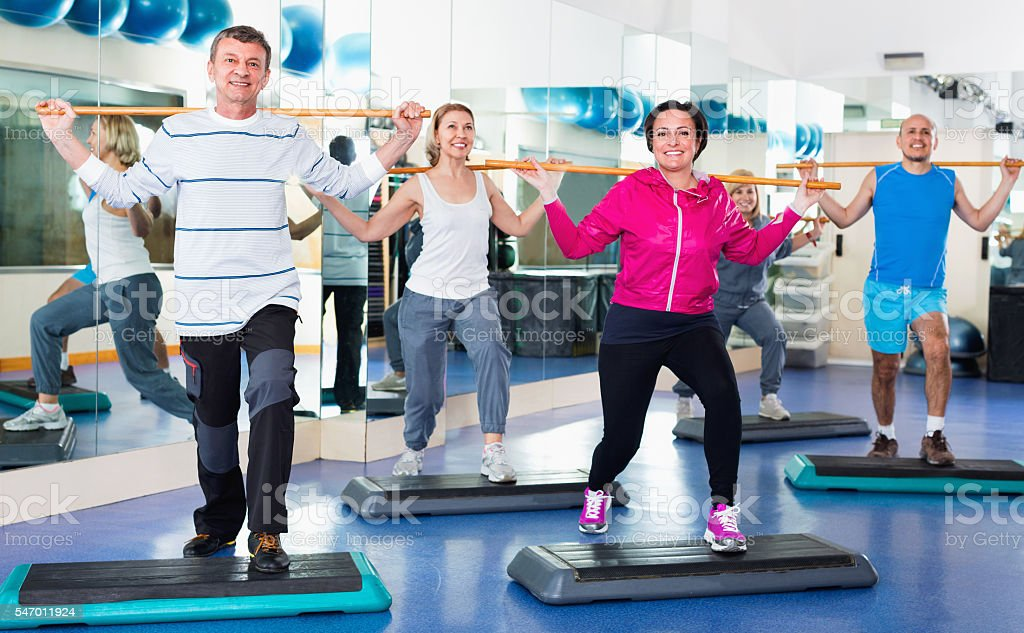 Men and women training in a gym stock photo