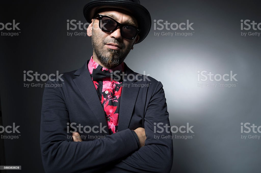 Men are arm in arm with sunglasses stock photo