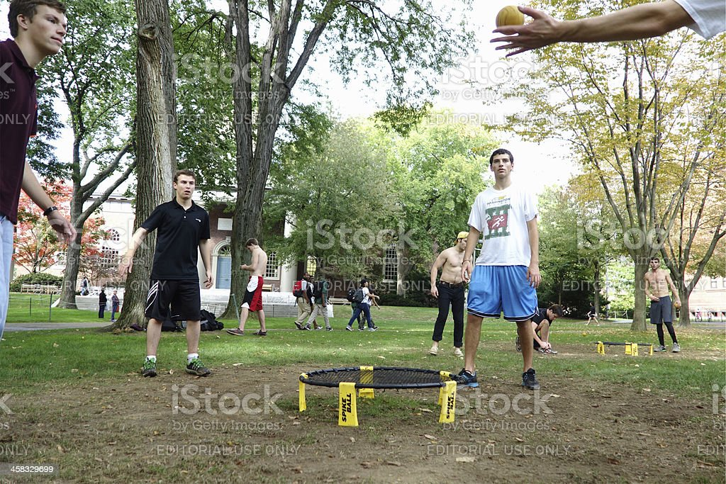 Men are playing spike ball stock photo