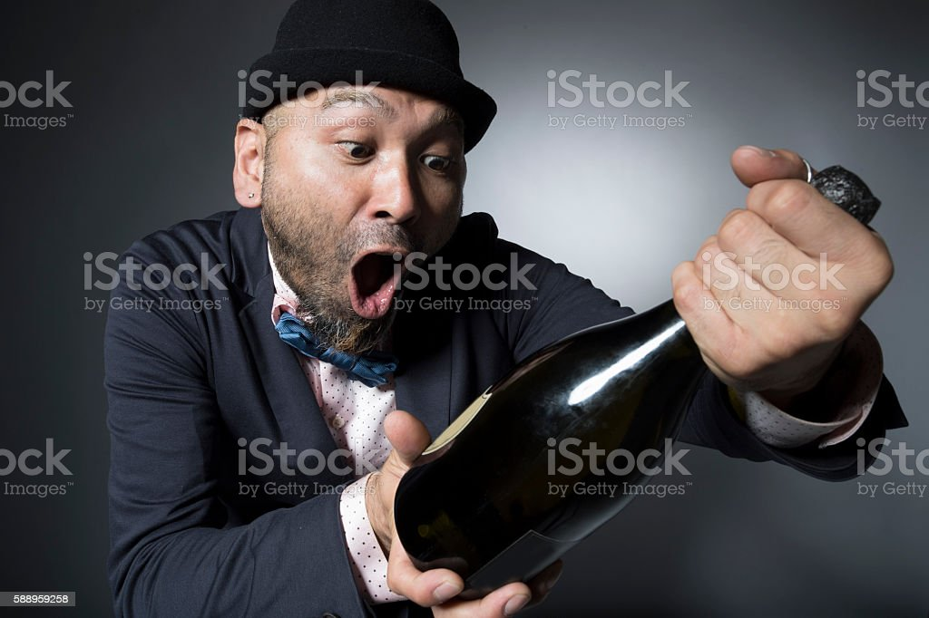 Men are surprised to champagne labels stock photo