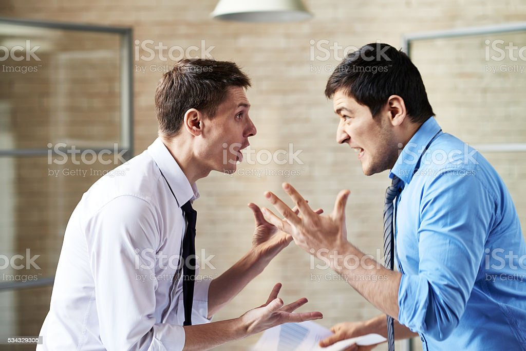 Men arguing stock photo