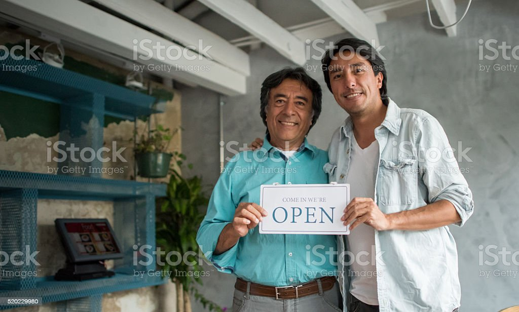 Men at a family business stock photo