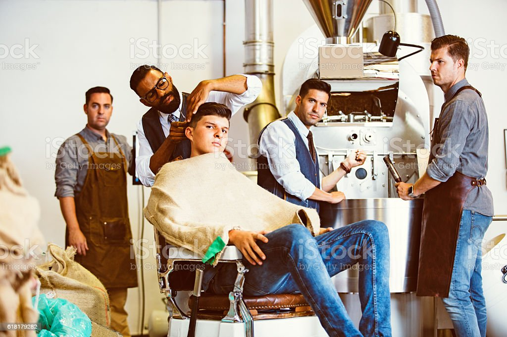 Men at coffee factory stock photo