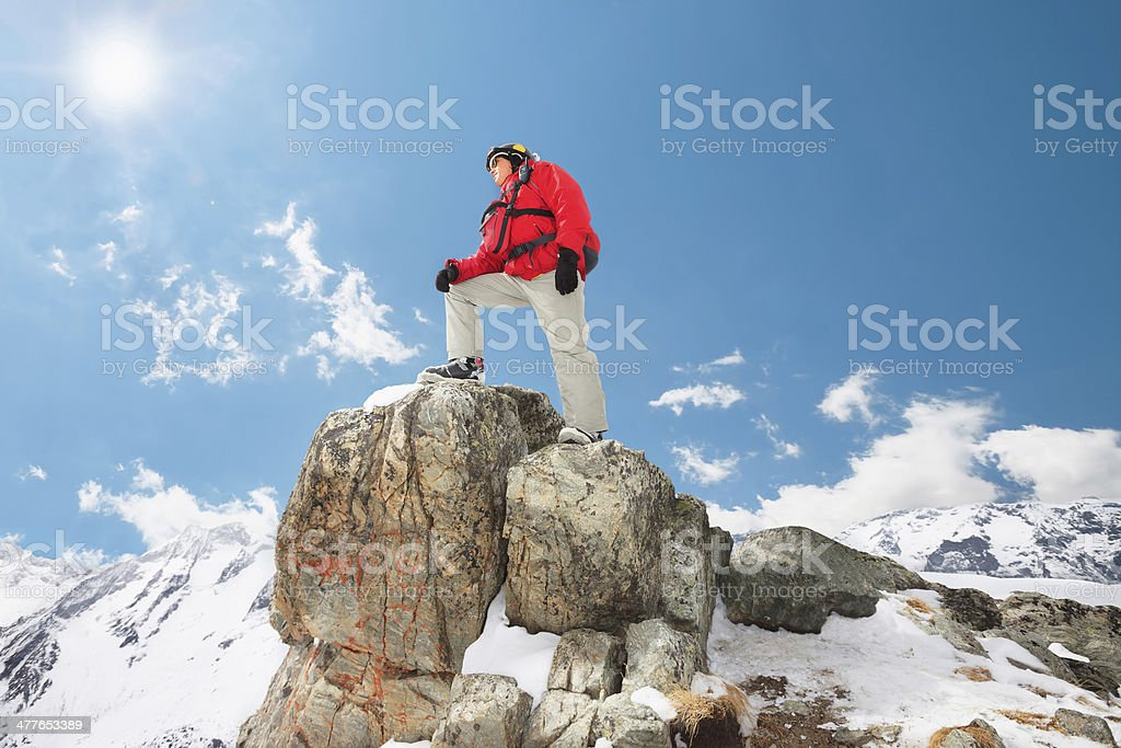 Men at the top of a mountain stock photo